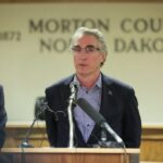 Fargo, North Dakota, mayor clashes with governor over whether the state should require people to wear face masks as COVID-19 cases multiply in the state