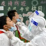 Strict lockdowns, experimental vaccine helped China recover from COVID-19