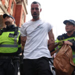 Anti-COVID-19 vaccine mob in London clashes with cops